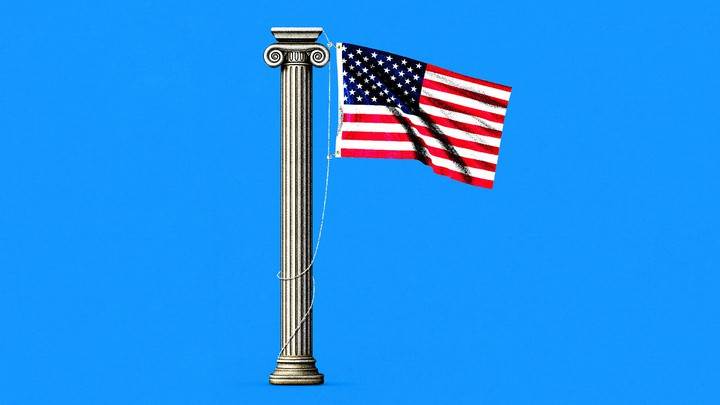 An American flag hanging from a Greek column