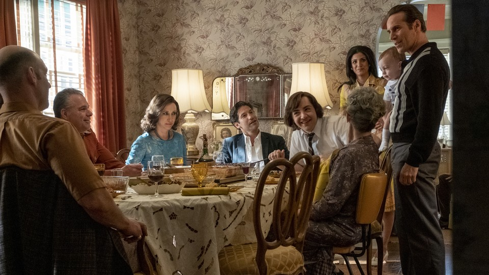 """a family gathered around a dining room table in """"The Many Saints of Newark"""""""