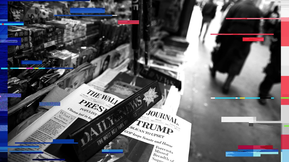 The cover of the Wall Street Journal is seen with other papers at a newsstand in New York on November 9, 2016.
