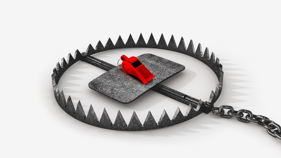 A red whistle sits inside an animal trap with sharp teeth