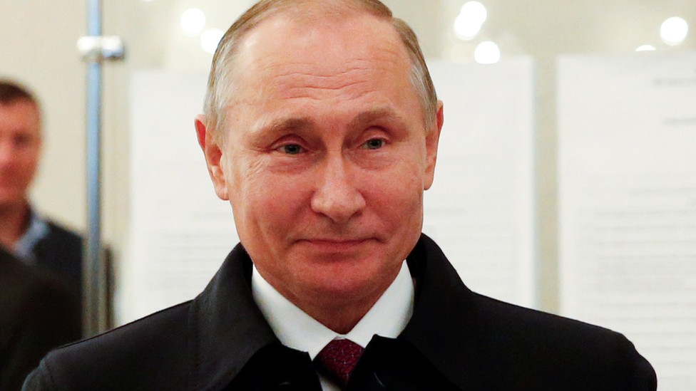 Russian President Putin visits polling station during parliamentary election in Moscow.