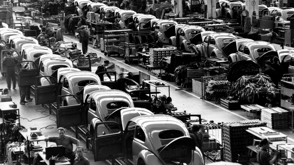 Beetles are assembled on production lines at Volkswagen's Wolfsburg, West Germany, plant in 1954.
