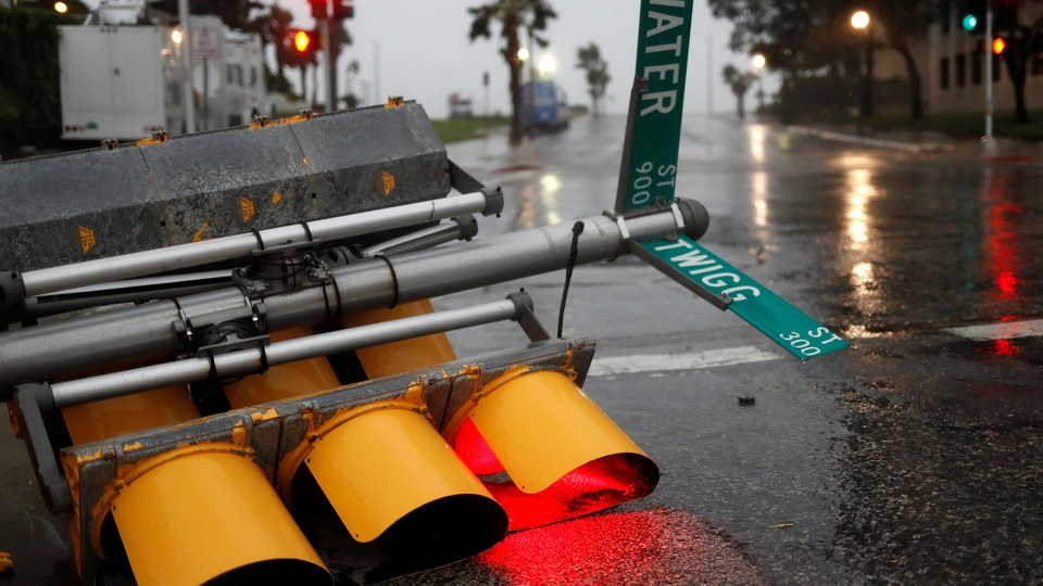 Traffic lights in Corpus Christi, Texas, are knocked down as Hurricane Harvey approaches.