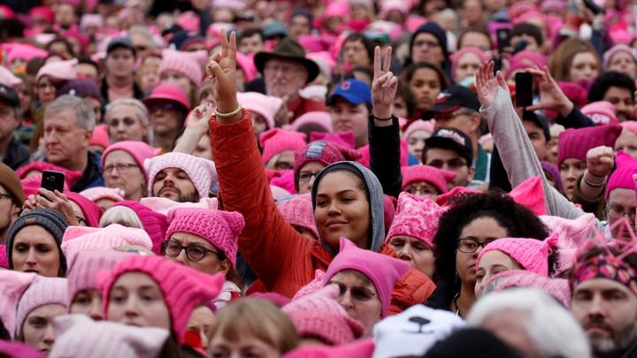 a crowd of women wearing pink hats