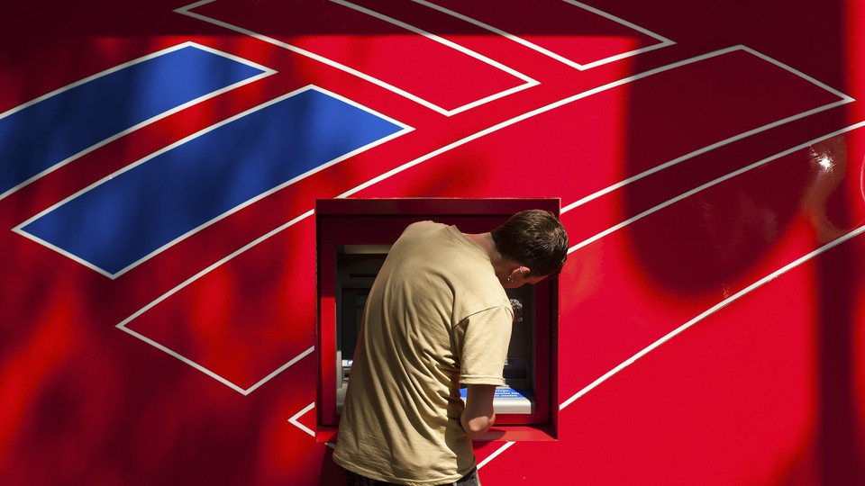 A man using a Bank of America ATM