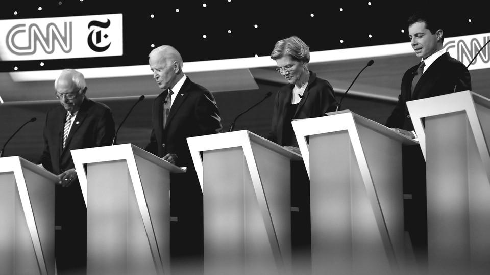 Senator Bernie Sanders (I-VT), former Vice President Joe Biden, Senator Elizabeth Warren (D-MA), and South Bend, Indiana, Mayor Pete Buttigieg look down during the Democratic presidential debate.