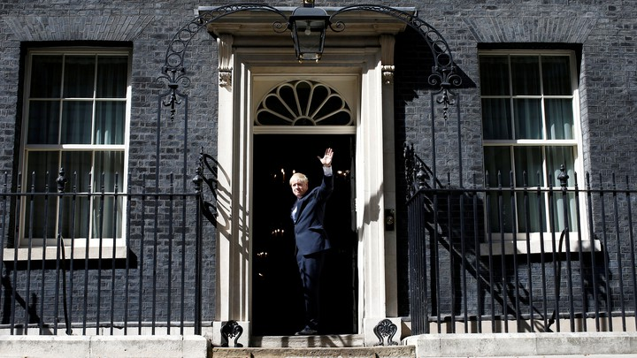 Boris Johnson walks through the door at Number 10 Downing Street.
