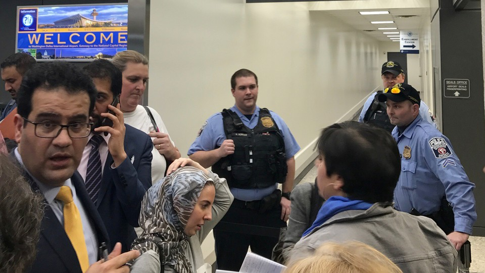 Lawyers gather to discuss how to gain access to detainees held under a travel ban imposed by President Donald Trump's executive order.