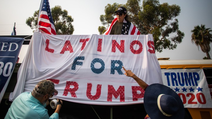 "A ""Latinos for Trump"" sign"