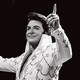 Dwight Icenhower dressed as Elvis on stage