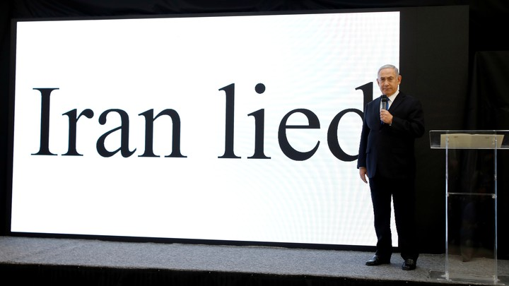 """Prime Minister Netanyahu in front of a screen that reads """"Iran lied"""""""