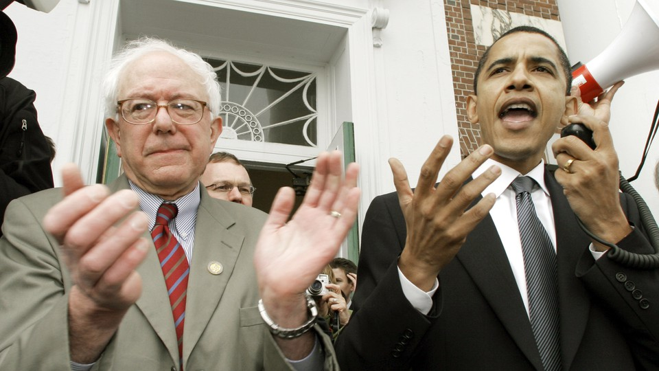 Barack Obama speaking at a Democratic rally in 2006 while Bernie Sanders claps beside him.