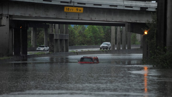 An abandoned Hummer is covered in floodwaters on Interstate 610 after Hurricane Harvey inundated the Texas Gulf coast with rain.