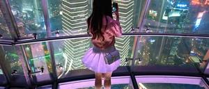 a photo of a woman taking a photograph in a Shanghai skyscraper
