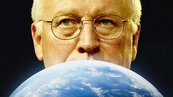Dick Cheney peering over a globe