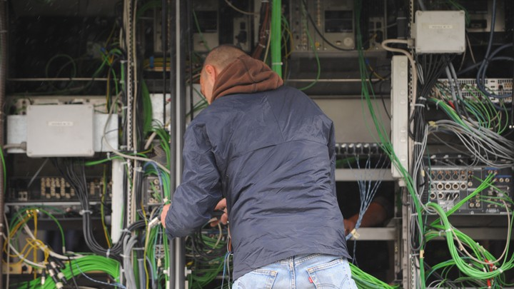 A technician arranges wiring ahead of a public event in Rome, Italy.
