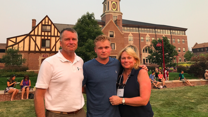 From left to right: James, Jonathan, and Mary Winnefeld at the University of Denver campus
