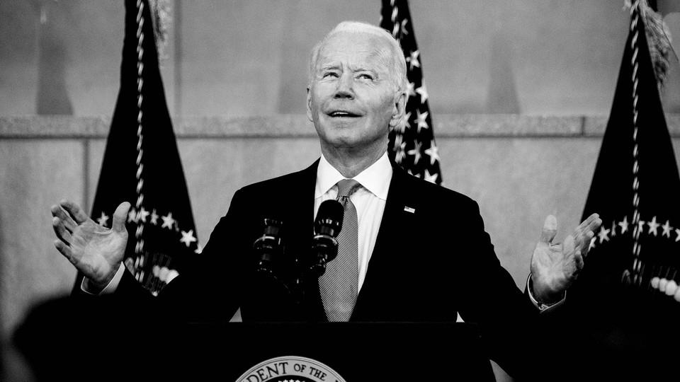 Joe Biden speaking at a podium.