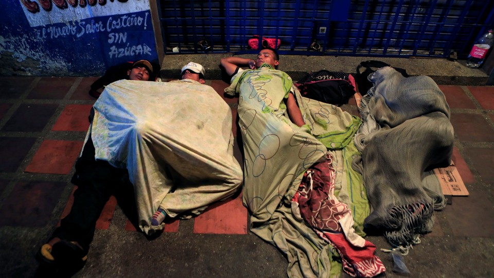 Venezuelan migrants sleep on makeshift beds in the streets of Maicao, Colombia, in February.