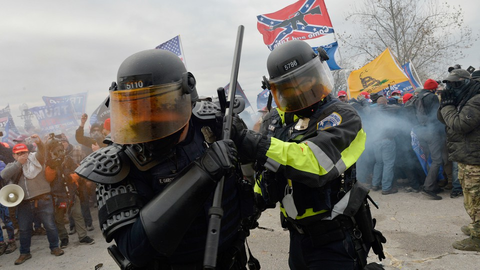 Trump supporters clash with police and security forces as they try to storm the U.S. Capitol.