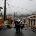 Rescue workers help residents in Guayama, Puerto Rico, after the area was hit by Hurricane Maria.
