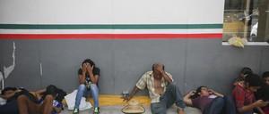 Asylum-seekers sit in Matamoros, Mexico, waiting to enter the U.S.