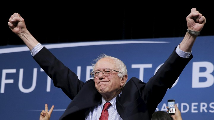 Bernie Sanders raises his fists in celebration at a campaign rally in Henderson, Nevada.