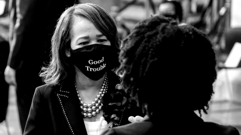 """Representative Lisa Blunt Rochester wearing a """"good trouble"""" mask"""