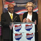 Two people stand at a podium in Ohio