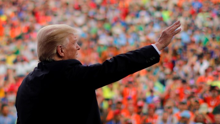 Donald Trump waves to a crowd of Boy Scouts.