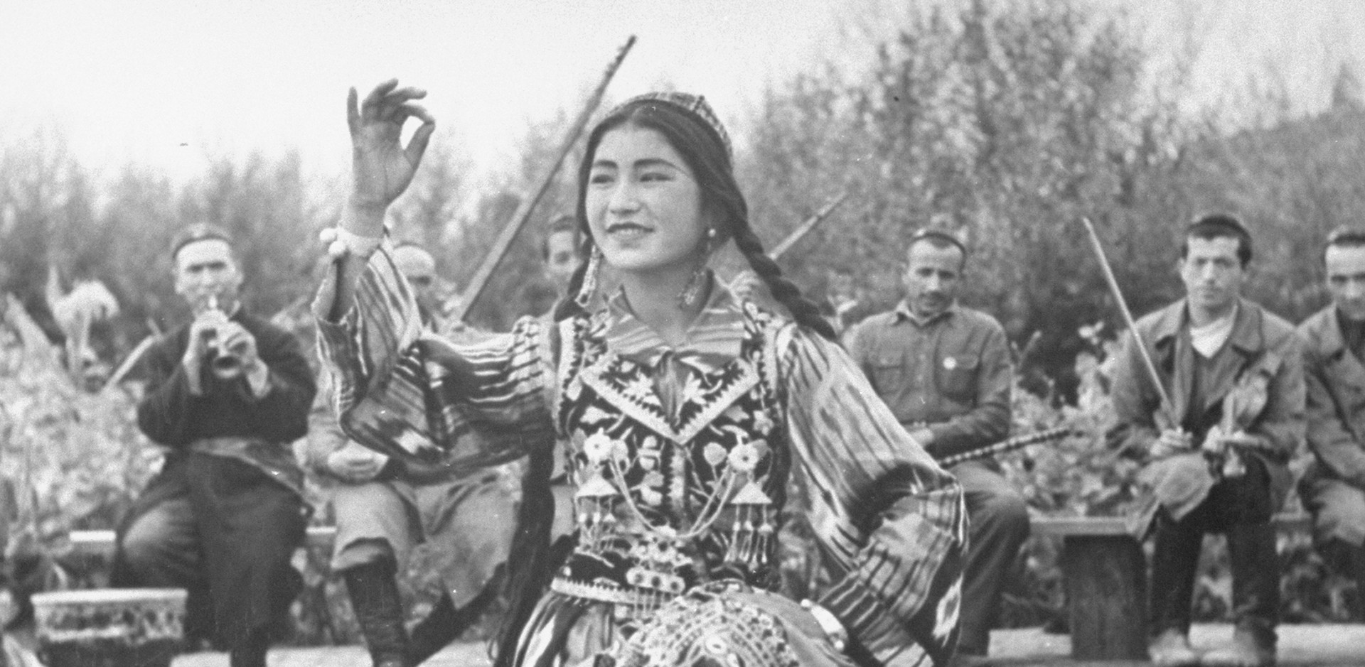 A photograph of a Uighur dancer performing to music