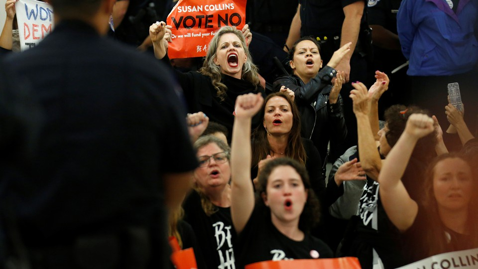 Protesters against Brett Kavanaugh chant in front of the office of Senator Susan Collins on September 24, 2018.