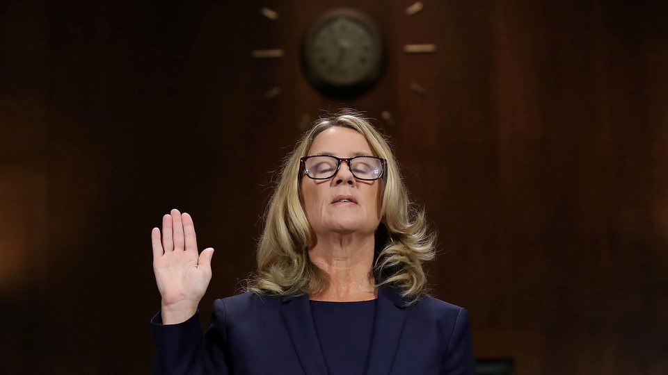 Christine Blasey Ford is sworn in before testifying the Senate Judiciary Committee in the Dirksen Senate Office Building at the Capitol Hill in Washington, DC, U.S., September 27, 2018.