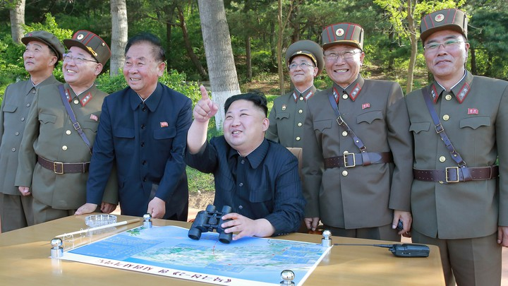 North Korean leader Kim Jong Un observes the intermediate-range ballistic missile Pukguksong-2's launch test in this undated photo released by North Korea's Korean Central News Agencyon May 22, 2017.
