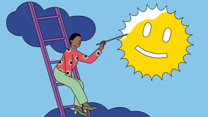 A woman paints a smiley face onto the sun