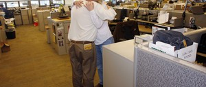 A photo of reporters Gary Massaro and Judi Villa in the newsroom of the Rocky Mountain News in Denver.
