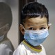 A child wearing a facemask