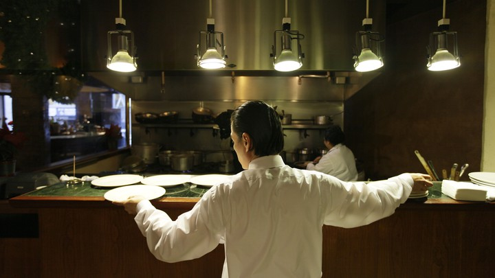 A waiter at a restaurant