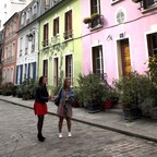 People stand on Paris's Rue Cremieux