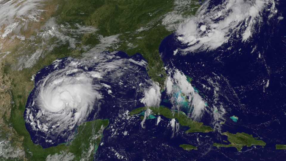 In a satellite image, Harvey approaches the Texas Gulf Coast as a tropical storm.