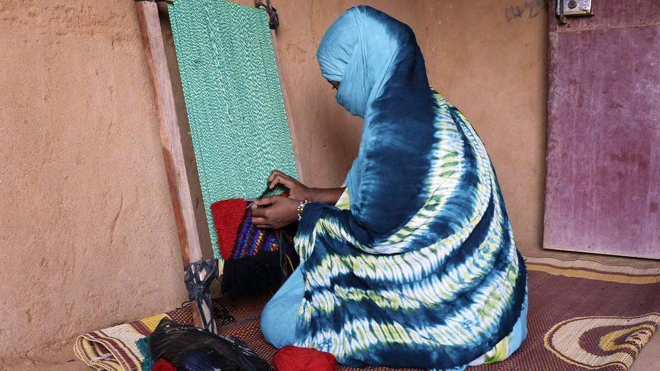 A woman weaving in Mali