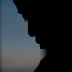 Silhouette of a boy looking down