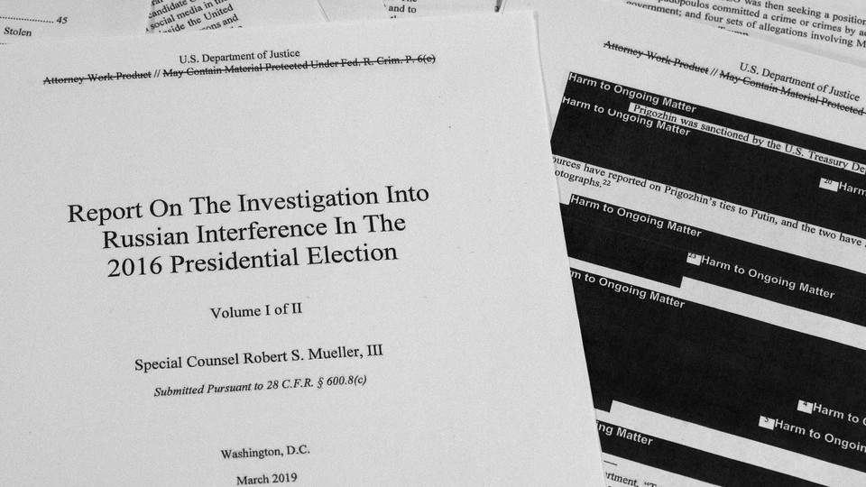 A photo of the redacted version of the Mueller report