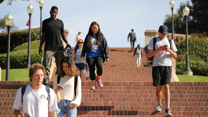 Students walking down steps on campus