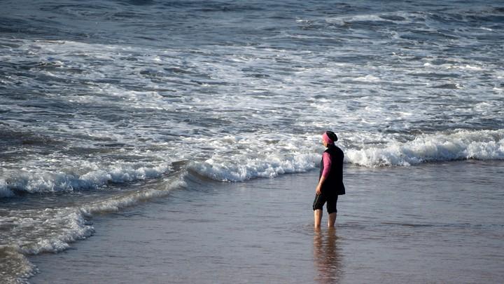 A women wearing a burqini at the beach.