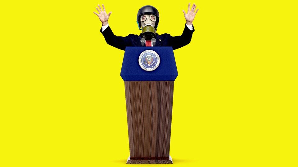 President Trump stands at a podium while wearing a gas mask with his hands raised.