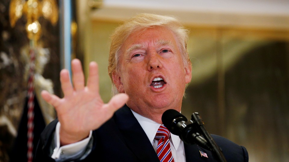 Donald Trump gestures at a press conference in Trump Tower.