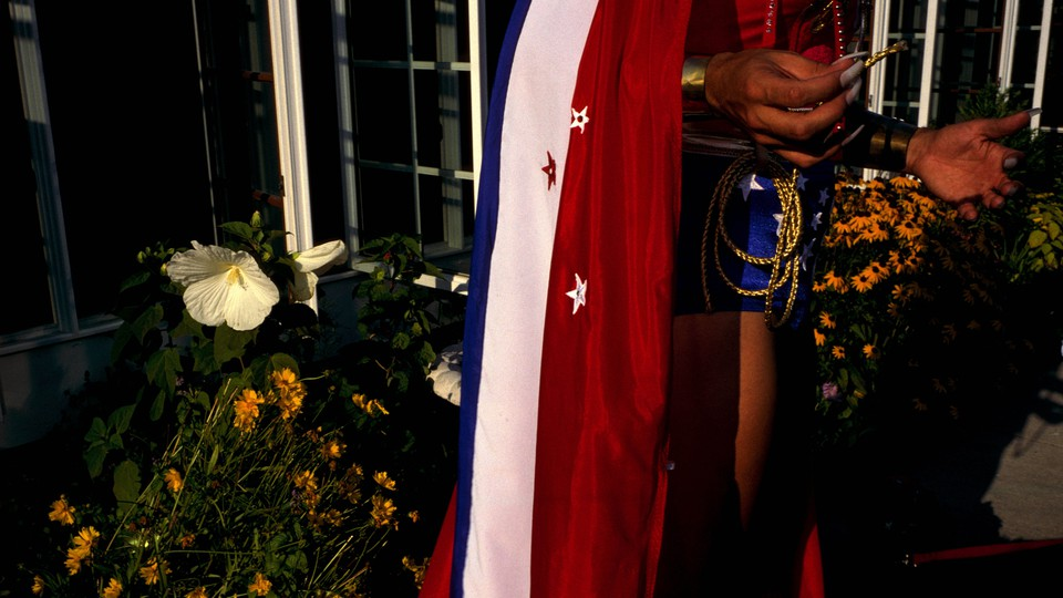 A waist-down view of a reveler wearing a red, white, and blue flag