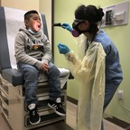 photo: A 7-year-old boy from Guatemala is tested for Covid-19 in Stamford, Connecticut, in May.