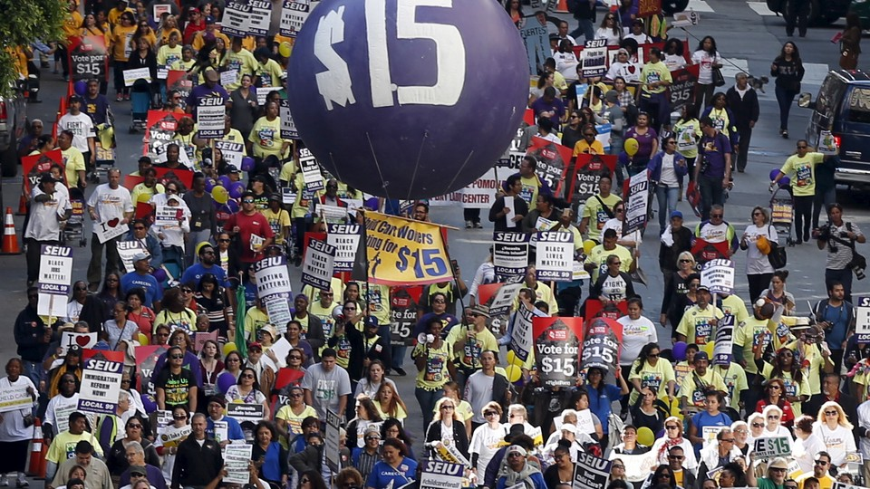 Demonstrators at a Fight for $15 rally to raise the minimum wage